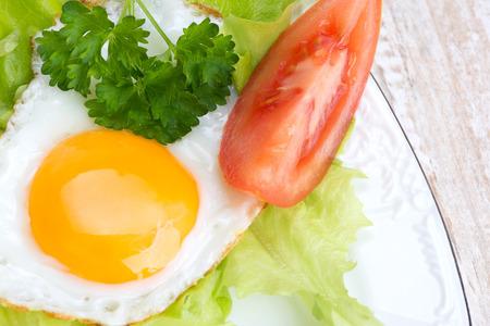Breakfast - scrambled eggs, lettuce, parsley, tomato Stock Photo