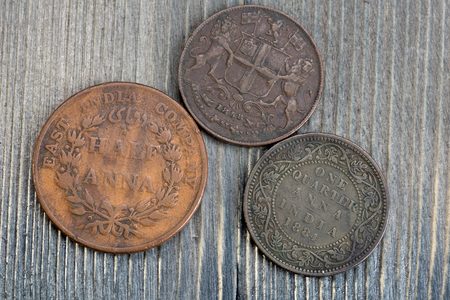 old coins of the East India Company - half and one quarter anna