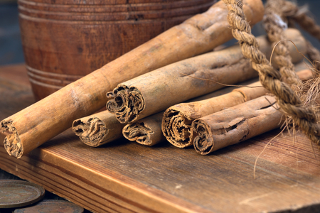 cinnamon sticks, coconut rope and old colonial coins