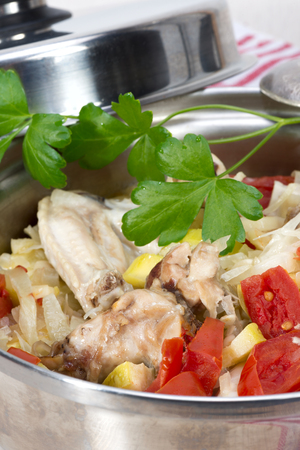 ragout of vegetables - zucchini, cabbage, onions and tomatoes with chicken cooked in its own juice