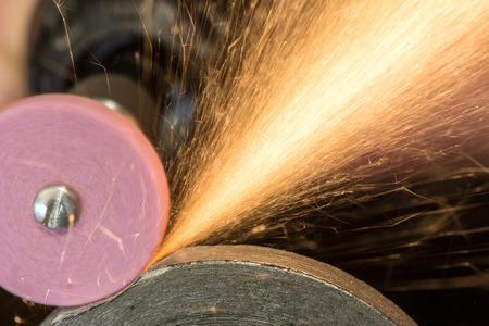 abrasive: grinding of steel by electric hand abrasive tools Stock Photo