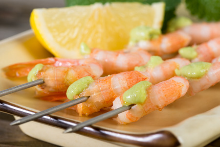 wasabi: shrimp threaded on skewers with wasabi sauce Stock Photo