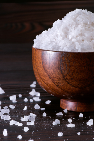 coarse crystalline sea salt in a wooden bowl Stock Photo