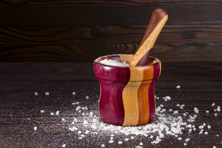coarse crystalline sea salt in a wooden mortar Stock Photo