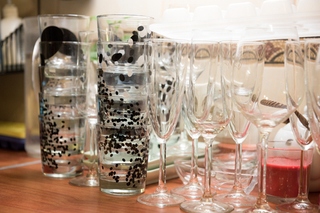 Clean glassful and wine glasses on the table