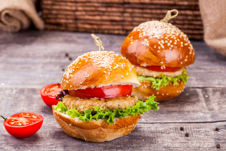 crispy: Chicken burgers on wooden table