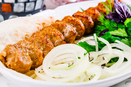 Mutton kebab with onion and herbs