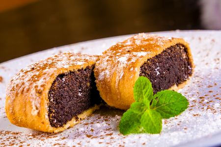 Strudel with poppy seeds on white plate Standard-Bild