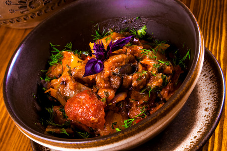 Caucasian cuisine. Ajapsandali with eggplant, pepper, tomato and herbs