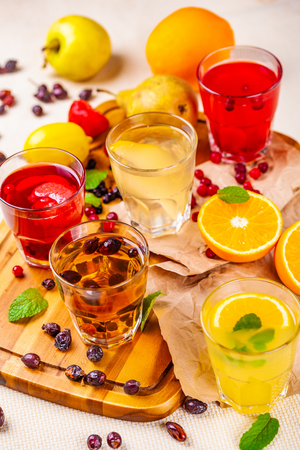 Berry fruit drinks and lemonades on wooden cutting board