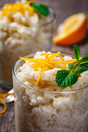 Rice pudding in a glass on wooden rustic table. Close up Stockfoto