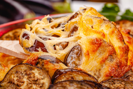 Greek Moussaka dish with minced meat, aubergine and sauce bechamel. Close up