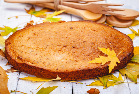 Semolina cake or manna pie with walnuts and raisins on wooden rustic table. Close up