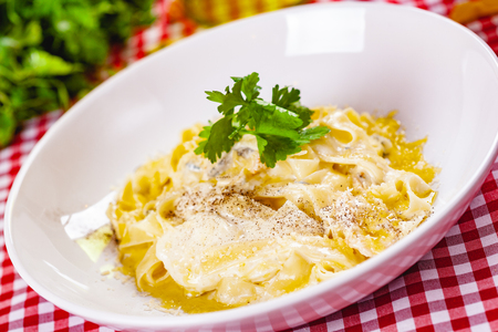 Italian Pasta with cheese on white plate. Close up Zdjęcie Seryjne - 121183683