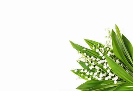 Beautiful bouquet of lilies of the valley isolated on white background. Top view with copy space. Flat lay