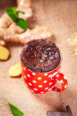 Baked ginger chocolate in red cup. Close up