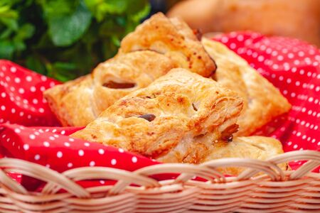 Pastry with apples and pumpkin seeds in basket on wooden table. Close up