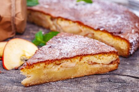 Pie with apple and pear on wooden rustic table. Close up Zdjęcie Seryjne