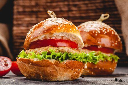 Chicken burgers on wooden background. Close up Zdjęcie Seryjne