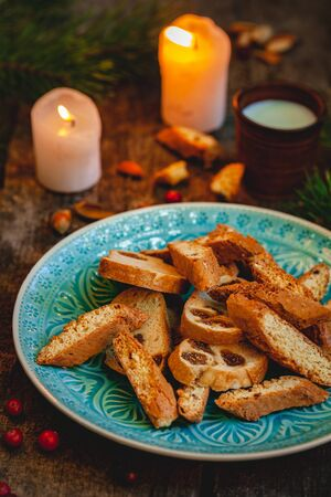 Biscotti or cantucci with milk on wooden rustic table. Close up. Christmas food concept Zdjęcie Seryjne