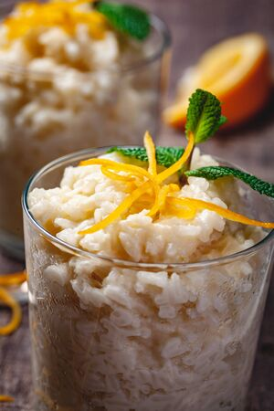 Rice pudding in a glass on wooden rustic table. Close up Zdjęcie Seryjne