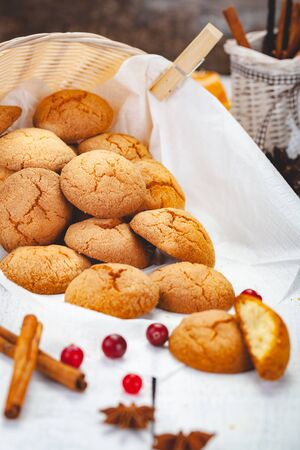 Homemade tangerine cookies on wooden rustic table. Close up