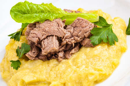 Beef Stroganoff with mashed potatoes on white plate