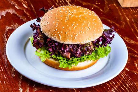 Hamburger on white plate Standard-Bild