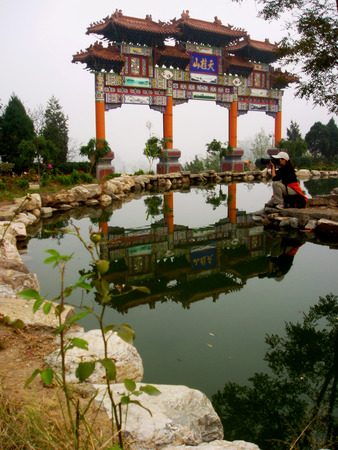 pavilion:  China days Guishan, photographers take pictures of the river curved, clear reflection, pavilion on the colorful and attractive,