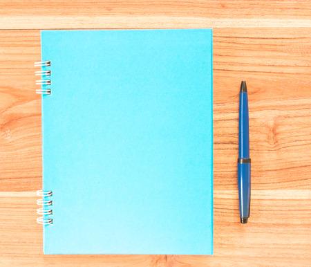 ballpen: Blank book cover with ballpen on board. Stock Photo