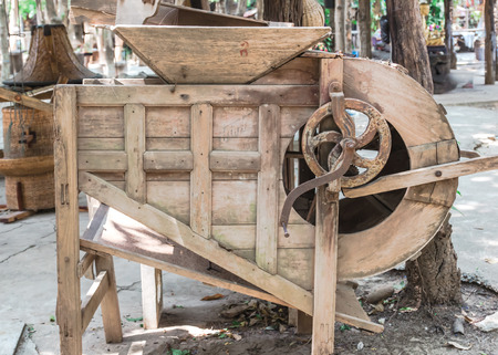 miller: Handmade ancient rice miller machine used for sort out rice seed  from spike after harvest from rice field.