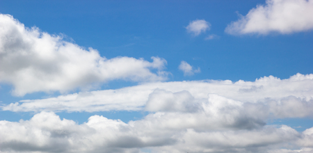 Fluffy white cloud over tropical blue sky. 写真素材