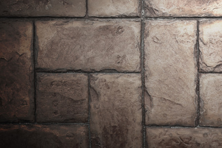 side lighting: Stone Tile Cement Brick Wall Background Texture with Lighting from Above side.