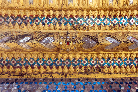 stucco: Antique gold frame Stucco wall Background Texture with Thai style pattern.