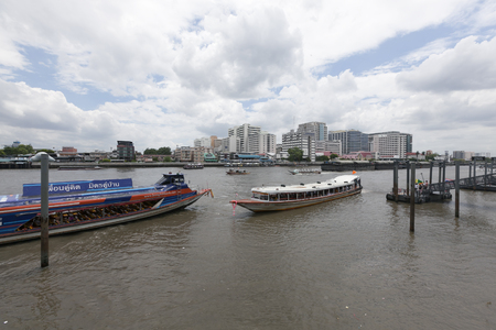 chao praya: BANGKOK, THAILAND - July 3 : Typical long tail boat on Chao Praya river in Bangkok on 3 July 2015. The river is a transportation artery for a network of water buses and taxis