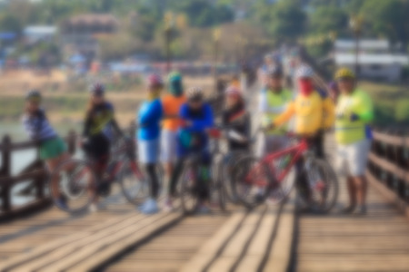 race for time: Blurred image of Cyclists are on the wooden bridge. Stock Photo