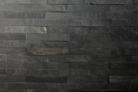 side lighting: Back Stone wall background texture with Lighting from above side. Stock Photo