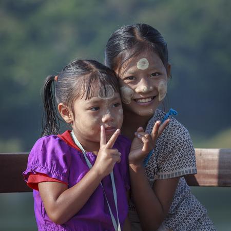 thanaka: Sangkhlaburi, Thailand - July 24, 2015: Unidentified young asian kids with thanaka powder on face of this mon identity , Mon village in Sangkhlaburi,Thailand.
