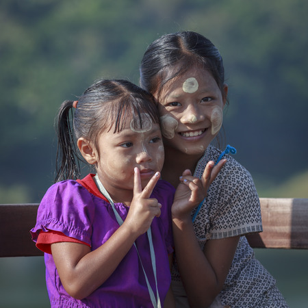 Sangkhlaburi, Thailand - July 24, 2015: Unidentified young asian kids with thanaka powder on face of this mon identity , Mon village in Sangkhlaburi,Thailand.
