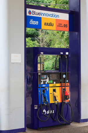 fueling pump: Kanchanaburi, Thailand - July 28, 2015: Gas pump nozzles in a service station. Editorial