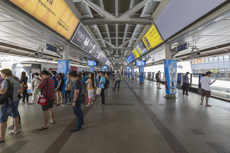 12 hour: BANGKOK, THAILAND - September 12, 2015: Peoples standing in lines waiting for BTS sky train at Siam station in rush hour on September 12, 2015 in Bangkok Thailand.