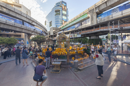 bombed city: Bangkok, Thailand, August 22, 2015: People worship Brahma Statue ,one of the greatest God in Hinduism Religion near the Erawan Hotel ,Ratchaprasong Intersection after bombed explosion.