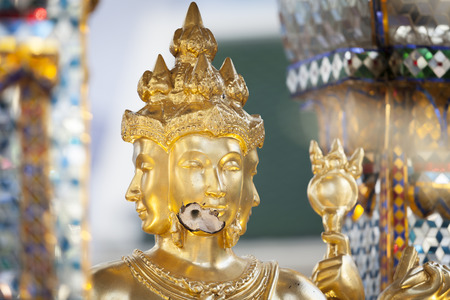 bombed city: Bangkok, Thailand - August 22, 2015: Broken face of Brahma Statue after explosion bombed at Ratchaprasong Intersection in August 18, 2015. Editorial
