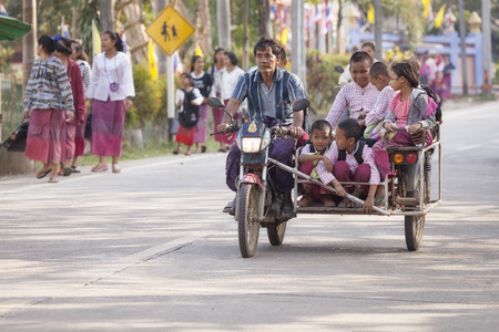 Sangkhlaburi, Thailand - January 23, 2015: Group of Students are in the Tri Motorcycle back from school at Sangkhlaburi.