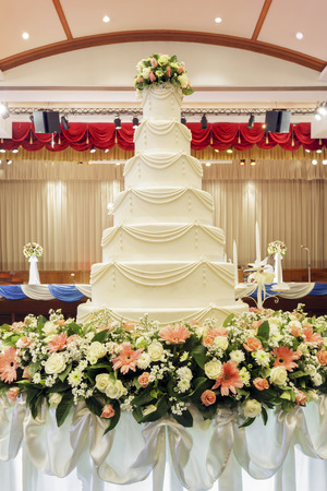 slice of cake: Wedding cake in wedding ceremony.