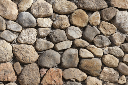 stacked stone: Stacked Stone Wall background texture. Stock Photo