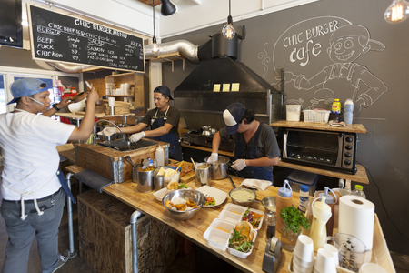 soi: Bangkok, Thailand - September 4,2015: Chefs are cooking in a kitchen at the CHIC BURGER CAFE. This cafe is located on Pracharatch road near the golden necklace temple (Wat Soi Thong) Bangkok, Thailand.