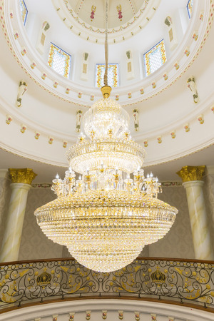 greece granite: A tungsten bulb crystal chandelier hanging from a ceiling.
