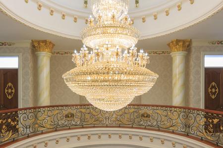 crystal chandelier: A tungsten bulb crystal chandelier. Editorial