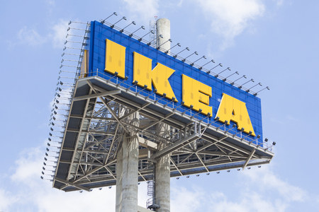 retailer: Bangkok, THAILAND - 2015 July 4: IKEA sign board against blue sky. As of January 2008, IKEA is the worlds largest furniture retailer. Editorial